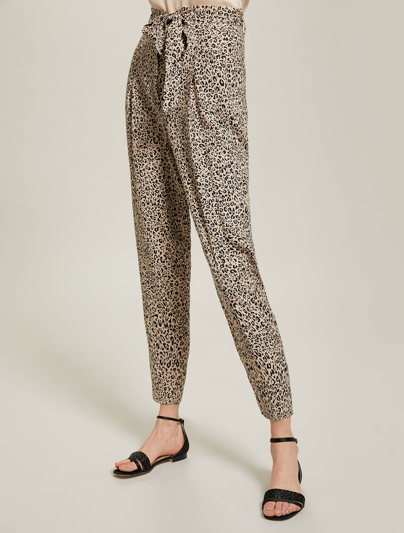 Leopard-print sablé trousers - sand pattern - pennyblack